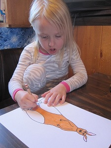 Coloring the recently drawn kangaroo. See the look of open-mouthed concentration.